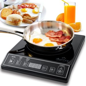 induction stove with egg and bacon
